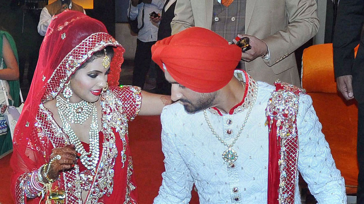Harbhajan Singh and Geeta Basra at their wedding. (Photo: PTI)