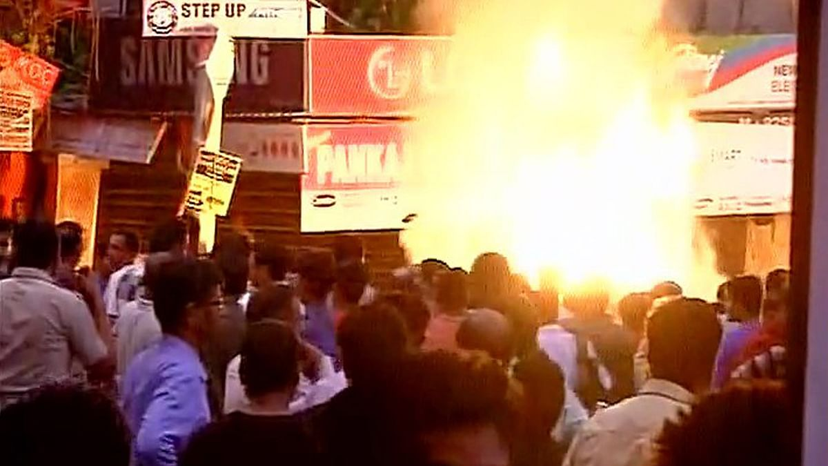 Following the incident,  angry locals gathered and set ablaze the shop in protest. (Photo: ANI)