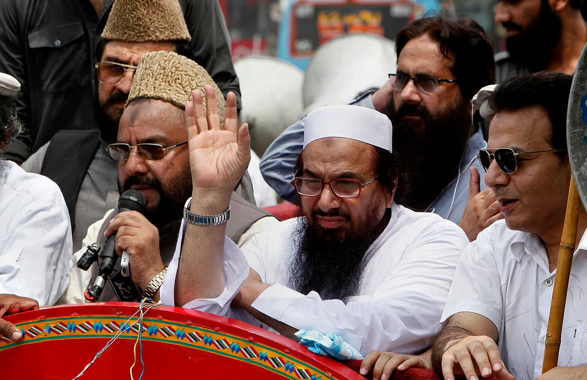 """In Lahore, Saaed dared India and said that he will march into the Indian side of Kashmir, and continue marching till """"Kashmiris get freedom."""" (Photo: AP)"""
