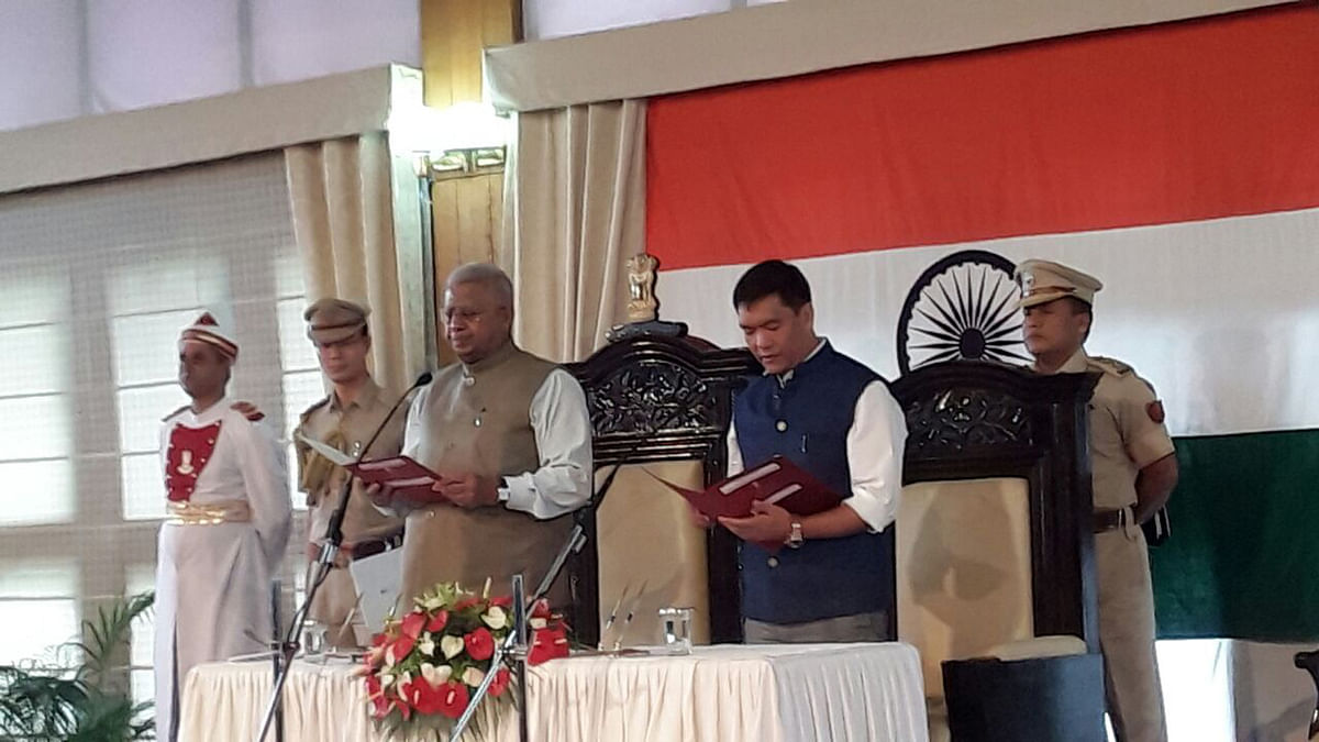 Pema Khandu, the country's youngest chief minister, being sworn-in by Governor Tathagata Roy on Sunday, 17 July 2016. (Photo Courtesy: Anjana Dutta)