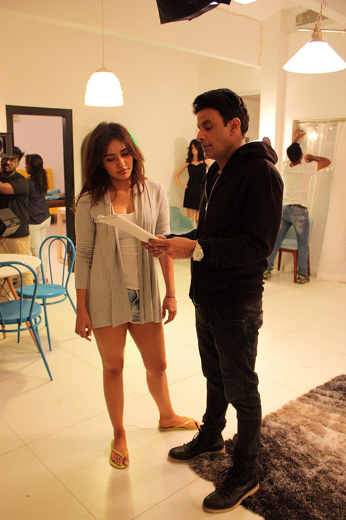 Manoj Bajpayee discusses a scene with Neha Sharma on the sets of Shirish Kunder's short film <i>Kriti. </i>(Photo courtesy: Image Smiths PR Team)