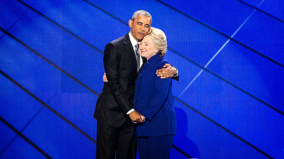 President Barack Obama hugs Democratic Presidential candidate Hillary Clinton after addressing the delegates during the third day session of the Democratic National Convention in Philadelphia, Wednesday, 27 July 2016. (Photo: AP)