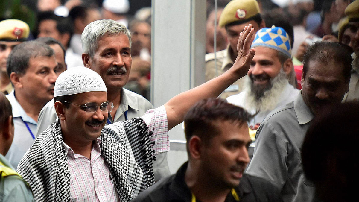 Delhi Chief Minister Arvind Kejriwal waves to muslims at an Iftar party hosted by him in New Delhi. (Photo: PTI)