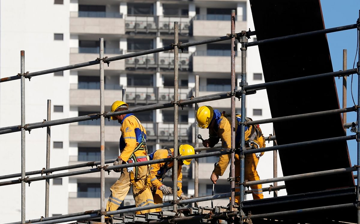 Workers at a construction site in Olympic Village. (Photo: Reuters)