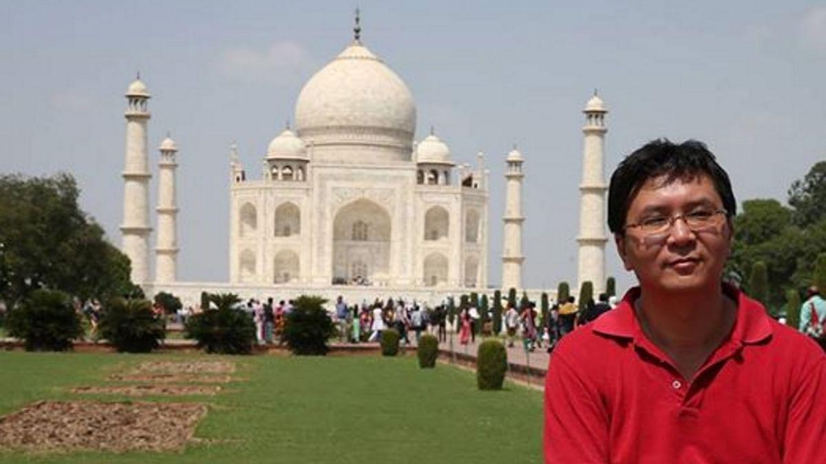"Wu Qiang at the Taj Mahal. (Photo Courtesy: <a href=""https://www.facebook.com/photo.php?fbid=1085304138162624&amp;set=a.154551347904579.35497.100000491445680&amp;type=3&amp;theater"">Facebook/Wu Qiang)</a>"