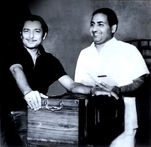 """<div class=""""paragraphs""""><p>Madan Mohan with Mohammed Rafi at a recording session </p></div>"""