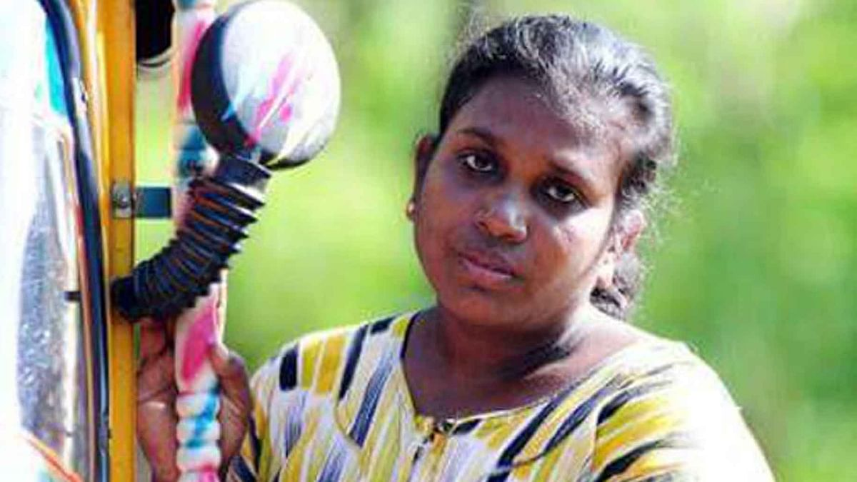 Chitralekha, the first Dalit woman to drive an auto-rickshaw in Kerala in 2005. (Photo: Indiaspend)