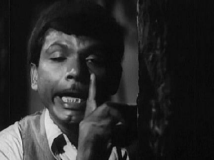 Johnny Walker plays the pickpocket master in <i>CID </i>(1956).