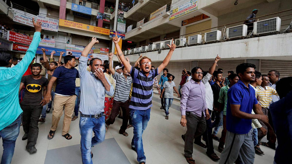 Members of Dalit Community forcing closure of markets   in Ahmedabad on Wednesday. (Photo: PTI)