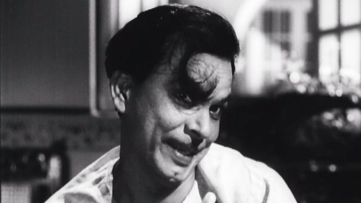 Johnny Walker in a comic scene from <i>Chaudhvin Ka Chand. </i>(1961).