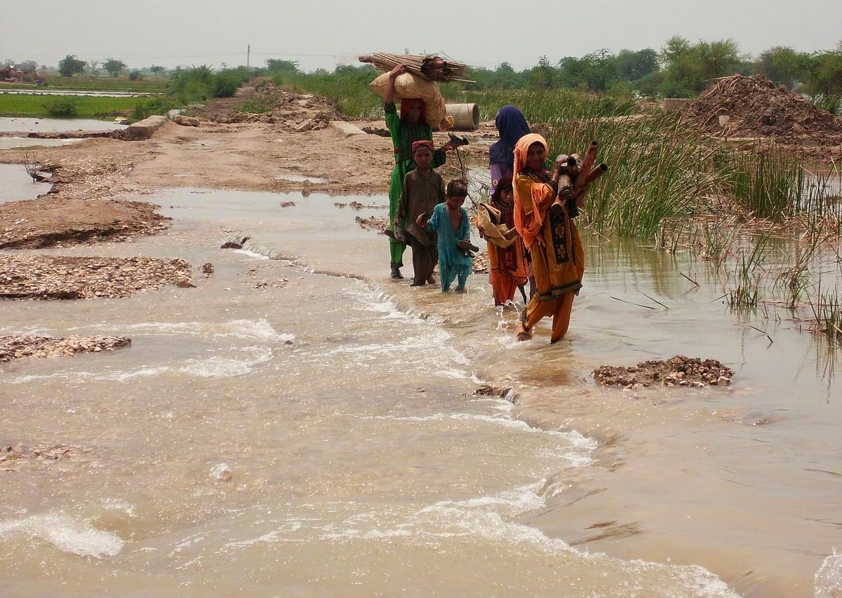 A Balochi family wades through flood waters in Jaffarabad district of Balochistan. Pakistan is accused of neglecting and exploiting the region. (Photo: Reuters)
