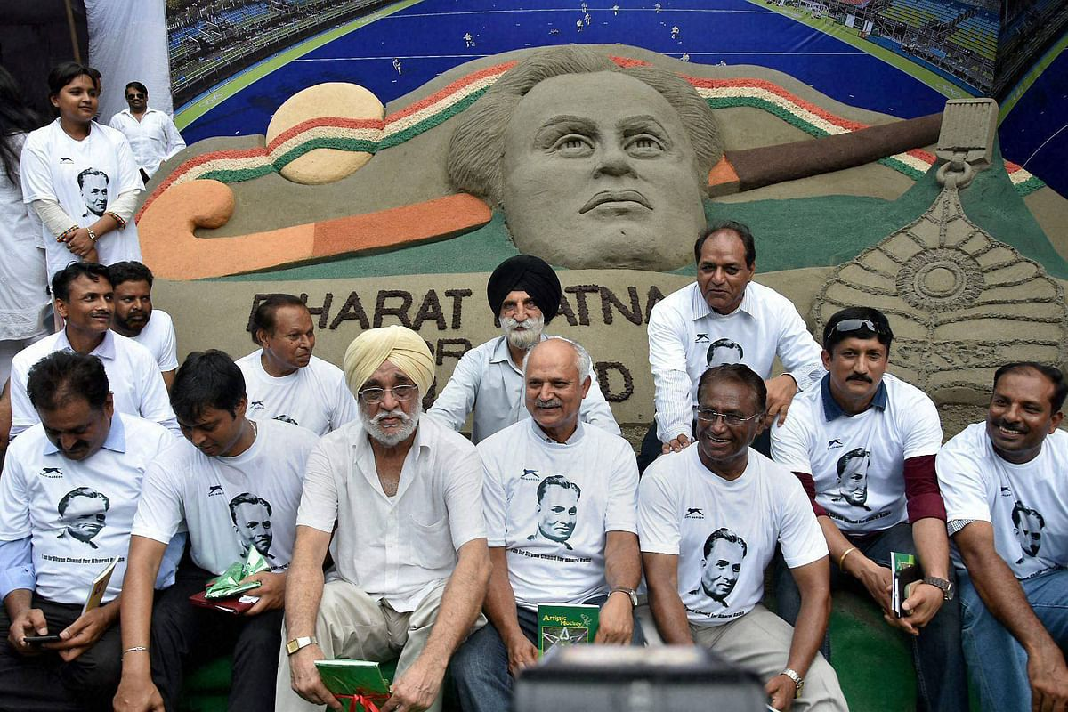 Former hockey players sitting at a demonstration in front of a sand image to demand Bharat Ratna honour for hockey legend Dhyan Chand, at Jantar Mantar in New Delhi on Sunday.