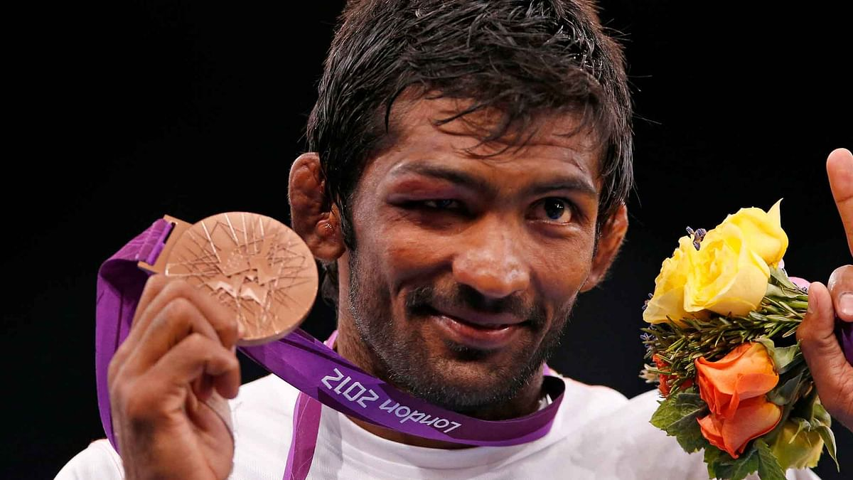 Yogeshwar Dutt with the bronze medal he won at the London Olympics. (Photo: Reuters)