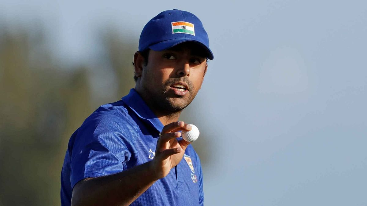 Anirban Lahiri, of India, holds his ball after finishing the 18th hole during the second round of the men's golf event at the 2016 Summer Olympics (Photo: AP)