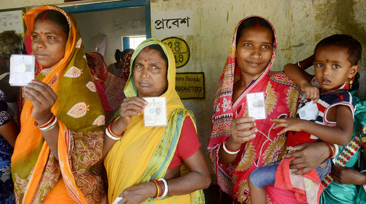 Women show their voter cards before casting votes at a polling booth during the  assembly elections in Kharagpur, West Bengal, April 2016. (Photo: PTI)