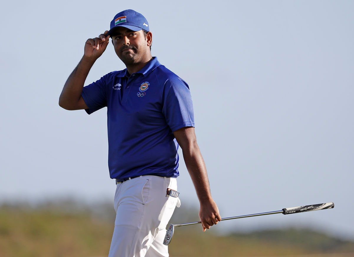 Anirban Lahiri, of India, carries his putter after finishing the 18th hole during the second round of the men's golf event at the 2016 Summer Olympics. (Photo: AP)