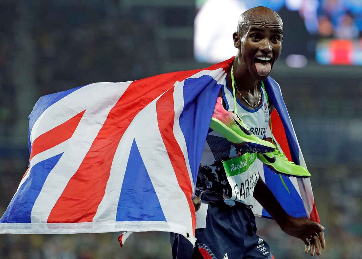 Britain's Mo Farah celebrates winning the men's 5000-meter race during athletics competitions at the Summer Olympics inside Olympic stadium in Rio de Janeiro, Brazil. (Photo: AP)