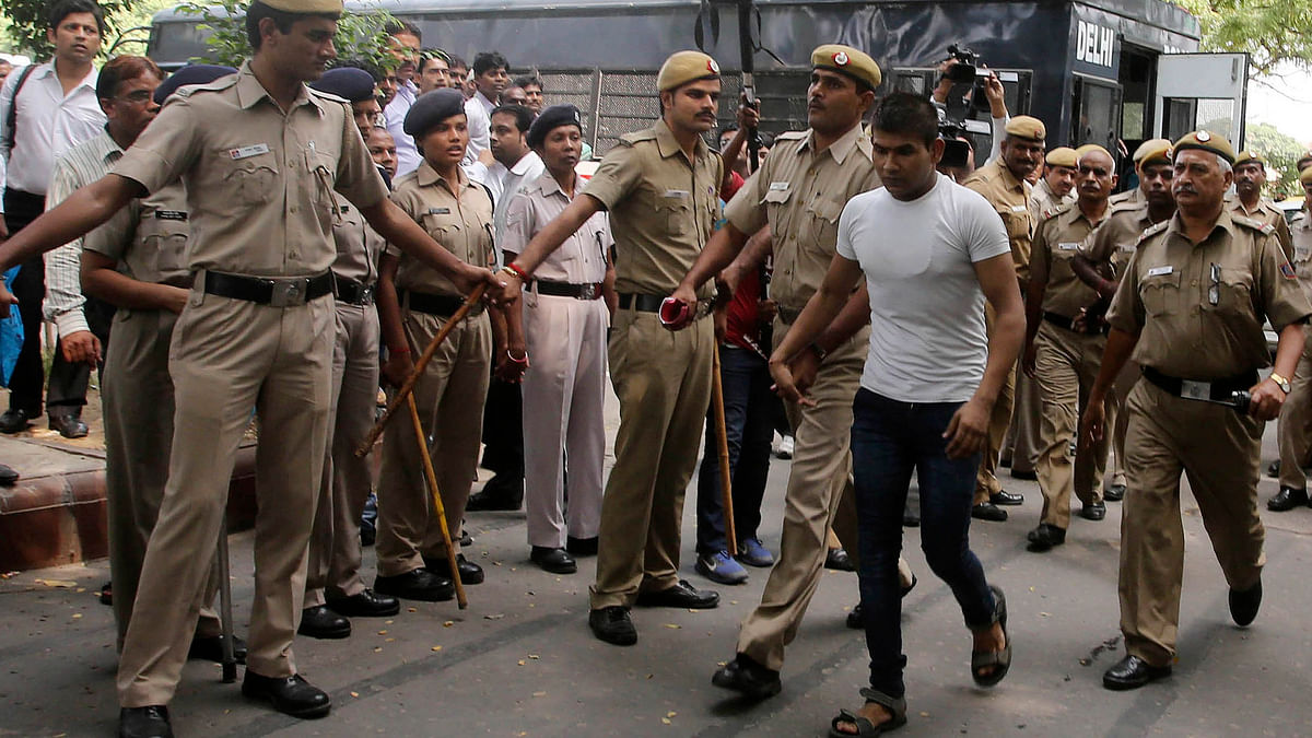 Vinay Sharma (wearing white T-shirt), one of the death row convicts in Nirbhaya case has been sentenced to 10 years in a separate robbery case.