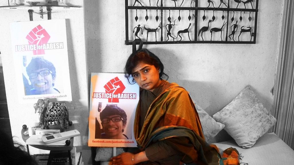 Aabesh Dasgupta's mother, Rimjhim Dasgupta, at her Lake Avenue residence in South Kolkata. (Photo: Sujoy Dhar/ <b>The Quint</b>)