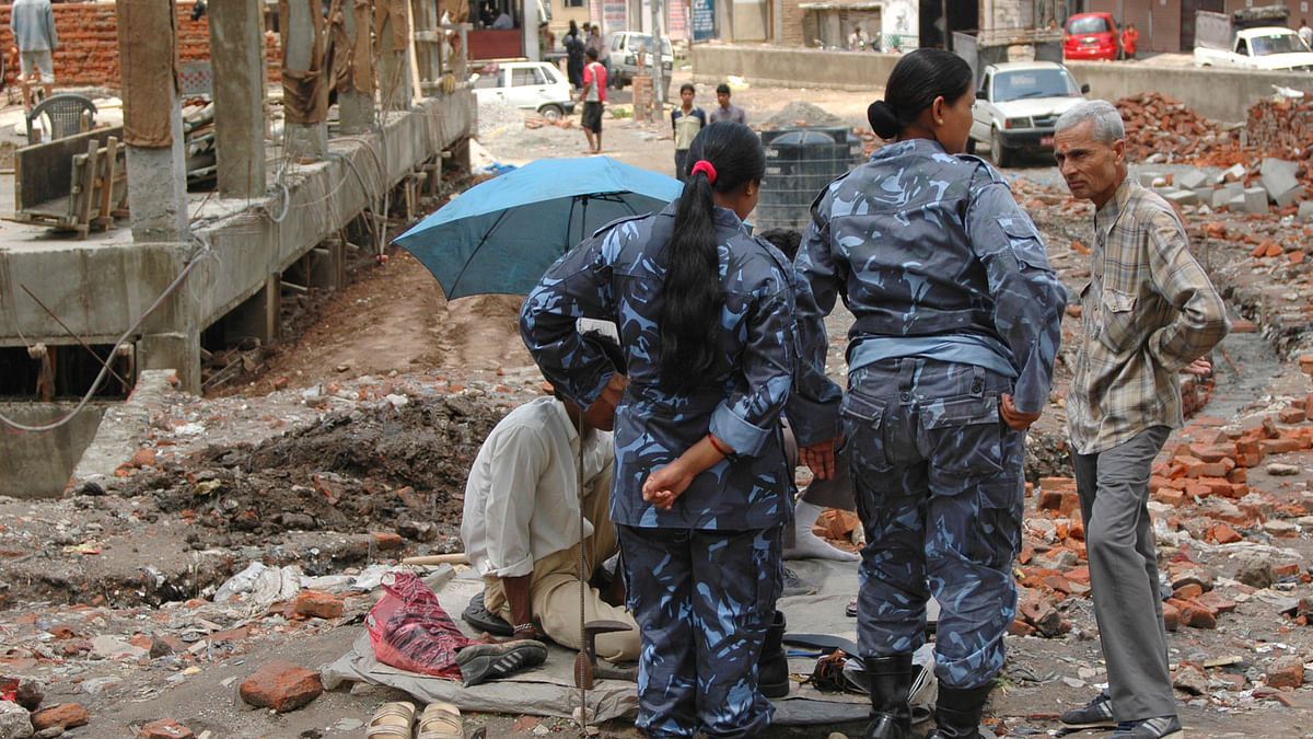 Police officers on duty at the site of a destroyed house in Nepal. (Photo: <i>iStock</i>)