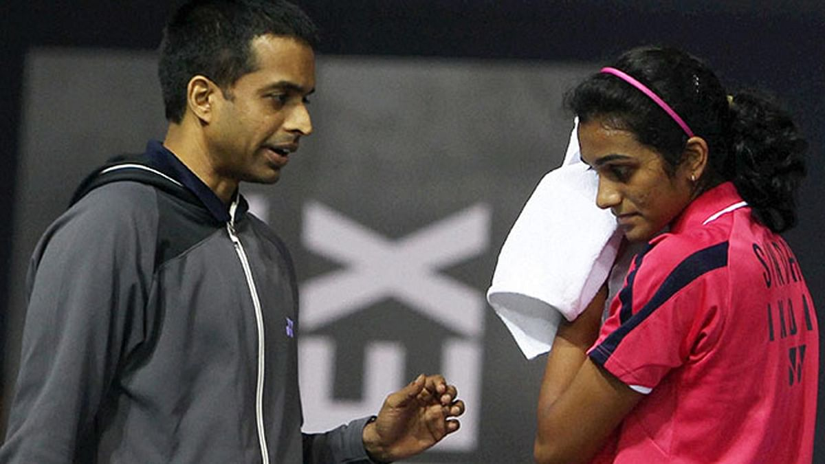 Coach Pullela Gopichand with PV Sindhu. (Photo: PTI)