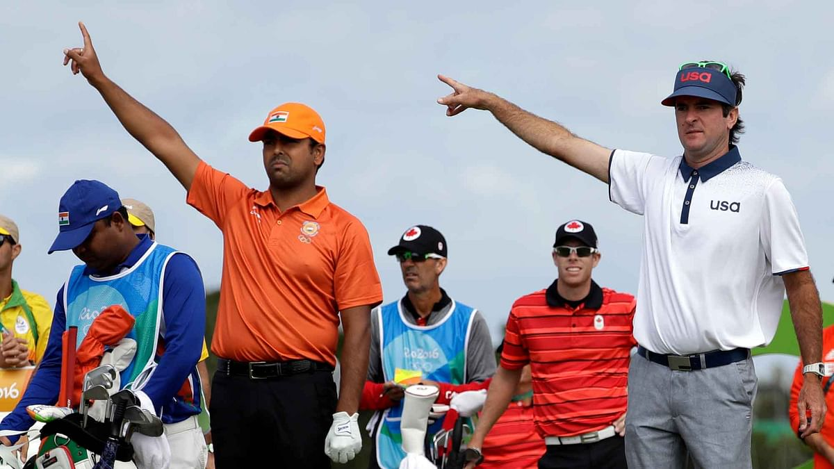 Bubba Watson of the United States, right, and Anirban Lahiri of India, gesture after Martin Kaymer of Germany's ball is hit on the 16th hole during the first round of the men's golf event at the 2016 Summer Olympics in Rio de Janeiro. (Photo: AP)