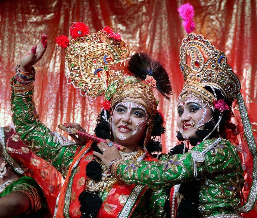 People dressed as Lord Krishna and Radha during Janmashtami celebrations. (Photo: PTI)