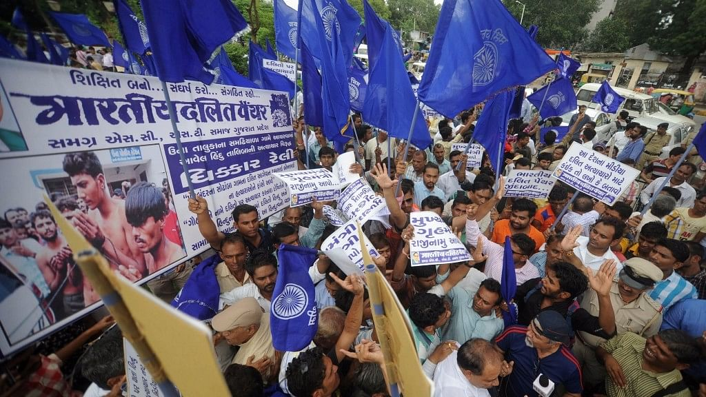 Bhartiya Dalit Panther (BDP) members stage a demonstration against Dalit Assault Case at Una, in Ahmedabad on 19 July, 2016. (Photo: IANS)
