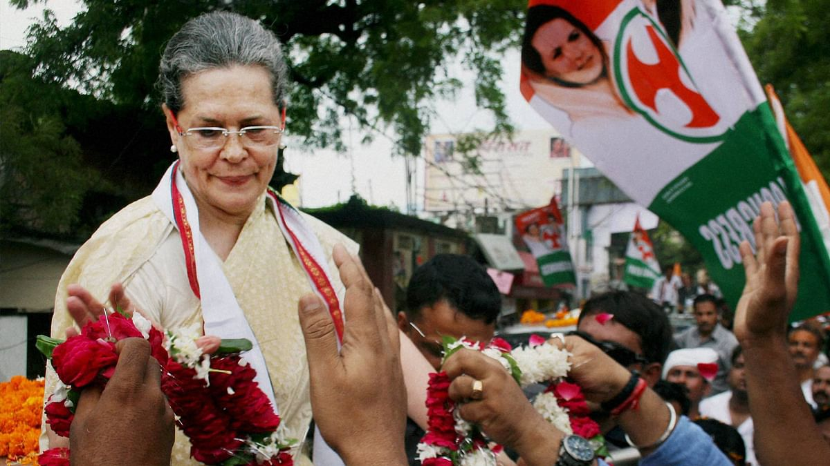 Congress Party President Sonia Gandhi receiving garlands during a road show before she fell ill in Varanasi on Tuesday.