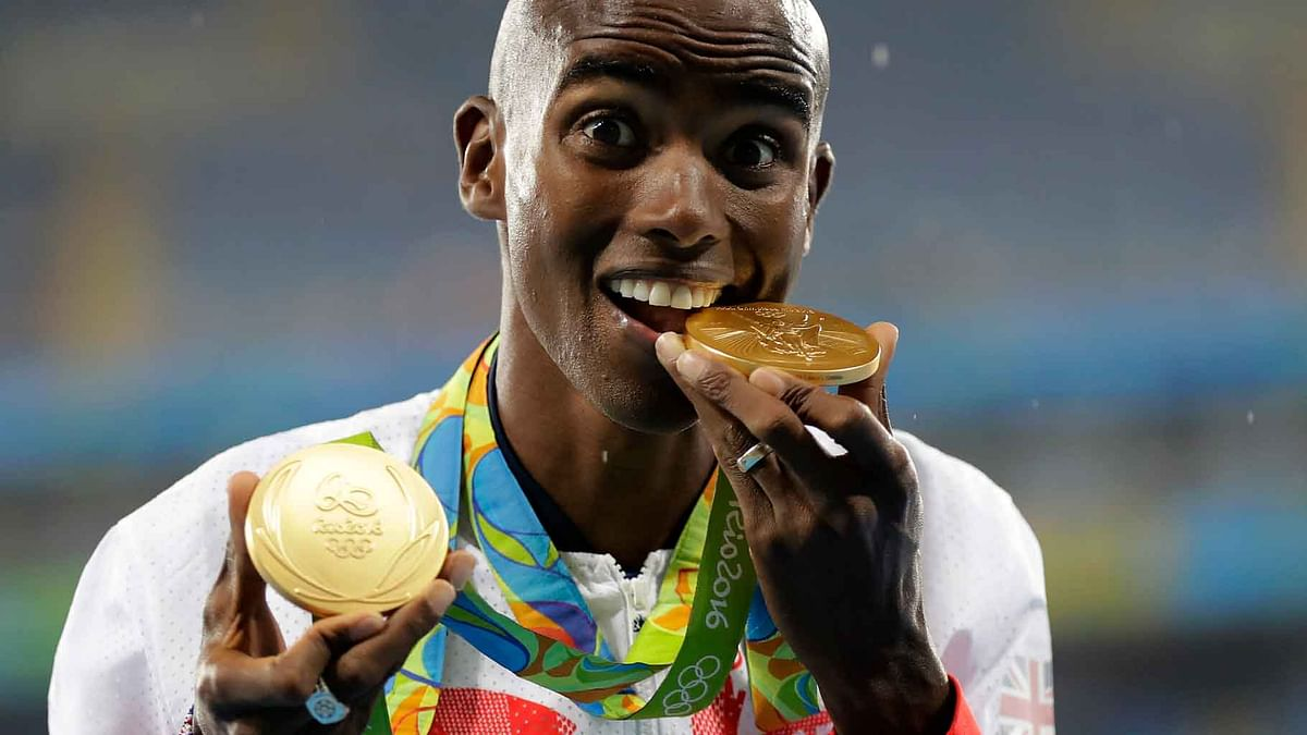 Britain's Mo Farah celebrates winning the gold medal, men's 5000-meter medals ceremony, during the athletics competitions of the 2016 Summer Olympics at the Olympic stadium in Rio de Janeiro, Brazil. (Photo: AP)