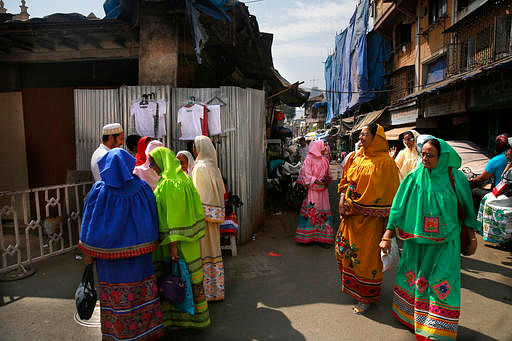 Dawoodi Bohra women walk past others shopping for clothes in a Bohra neighborhood in Mumbai. The Dawoodi Bohras are an affluent trading community of about a million people concentrated mostly in Mumbai, but also seen across the United States and Europe. (Photo Courtesy: AP Images)