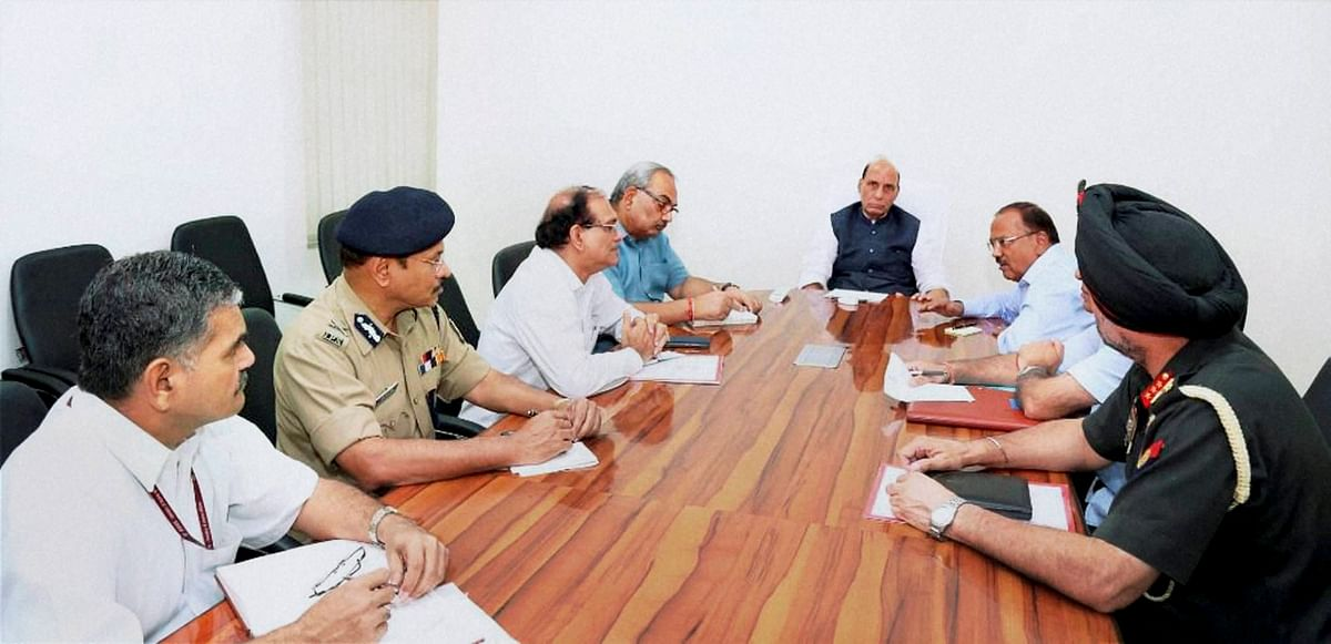 Home Minister Rajnath Singh holding a high-level security meeting at his residence in New Delhi on Sunday in the wake of terror attack at 12th brigade headquarters in Uri. (Photo: PTI)
