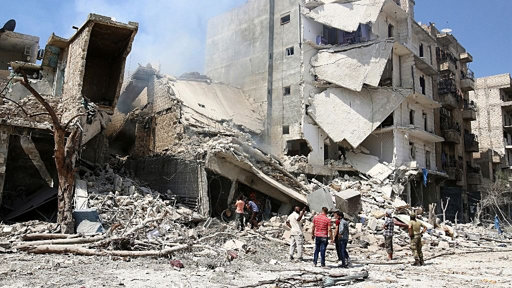 Men inspect a damaged site after double airstrikes on the rebel held Bab al-Nairab neighborhood of Aleppo, Syria. (Photo: Reuters)