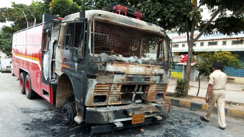 A fire tender  was doused by protesters in Bengaluru on 13 September 2016. (Photo: IANS)