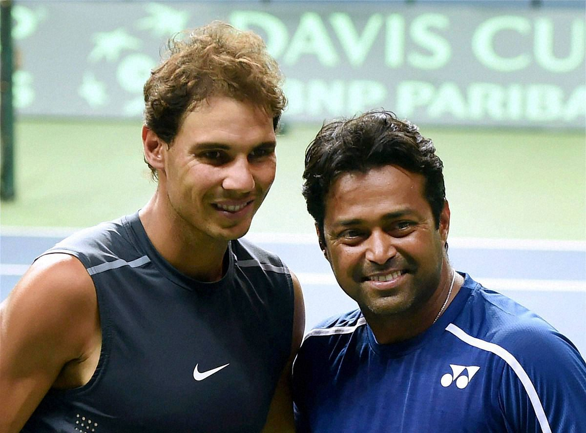 New Delhi: Spain's Rafael Nadal with India's Leander Paes poses for photographs during a practice session in New Delhi on Tuesday ahead of the Davis Cup matches. (Photo: PTI)
