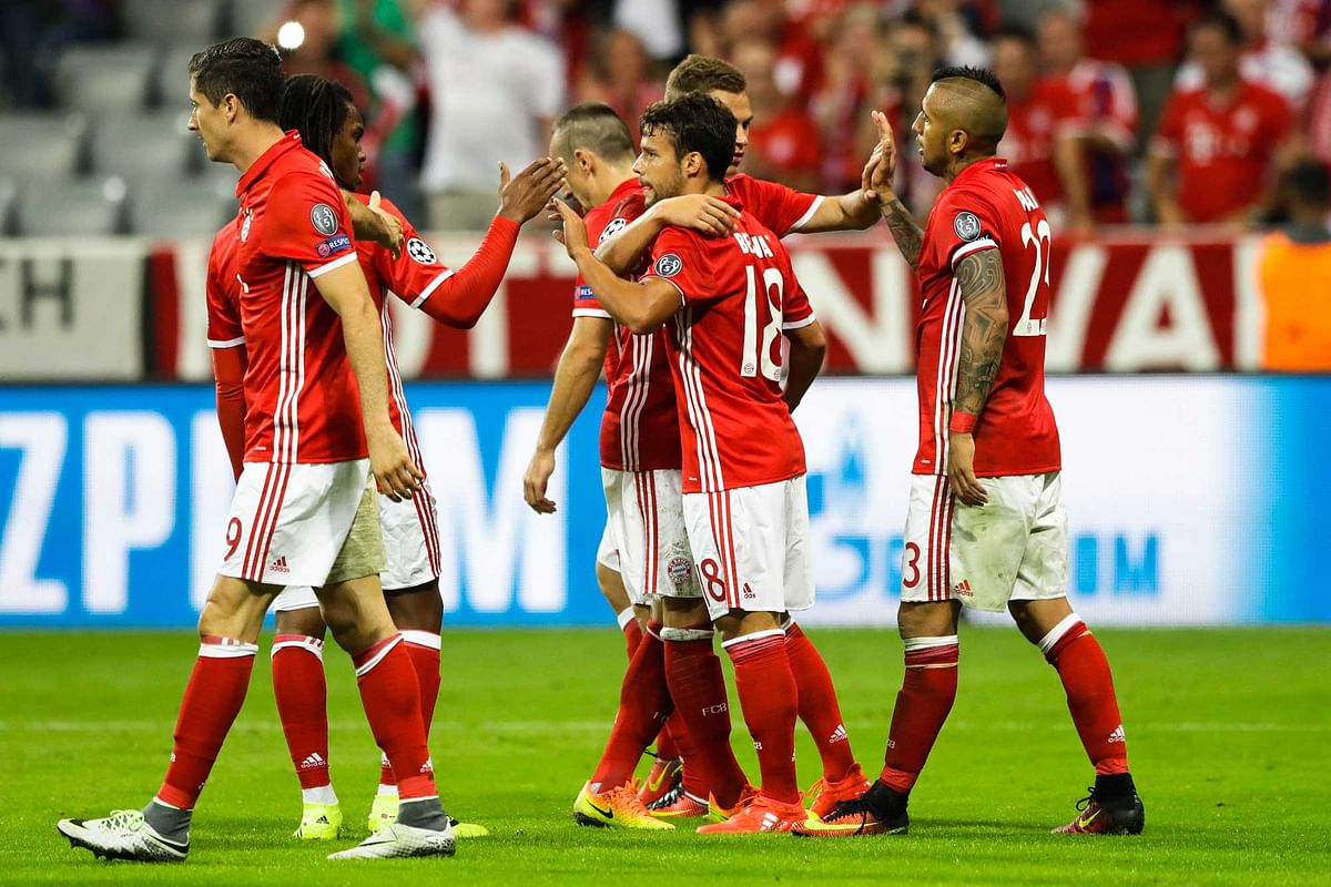 Bayern's Juan Bernat, center 18, celebrates with team mates after scoring their side's fifth goal during the Champions League Group D match. (Photo: AP)