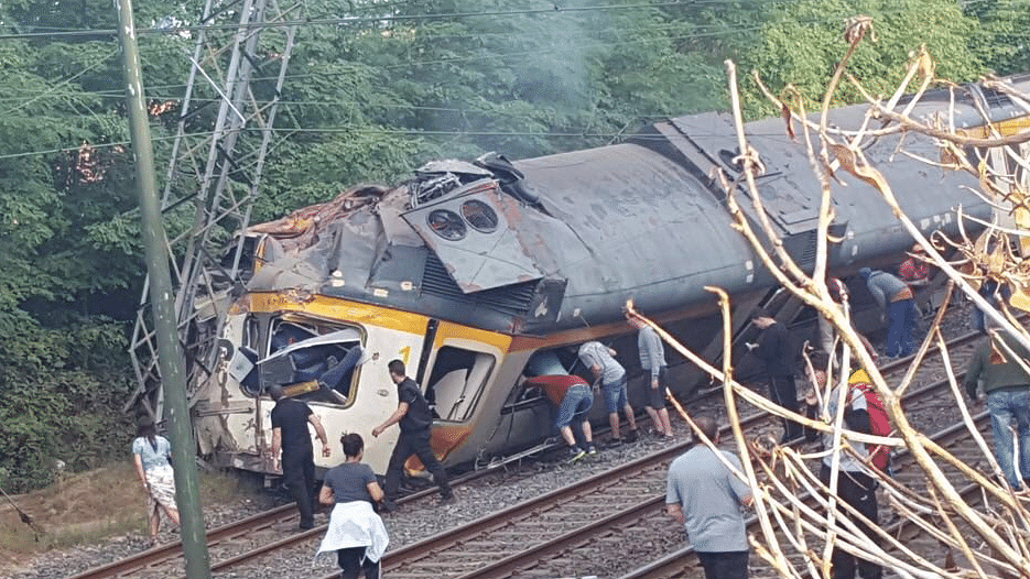 "Photo of the train derailed near Pontevedra in north-west Spain. (Photo Courtesy: Twitter/<a href=""https://twitter.com/GxDRadioGalega/status/774156014593544193?ref_src=twsrc%5Etfw"">Galicia por Diante</a>)"