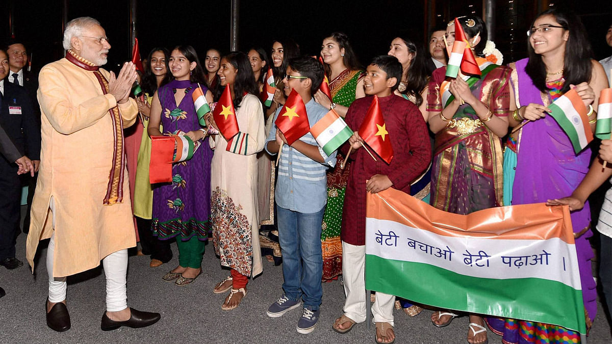 Over a hundred expatriate Indians gathered at a hotel in Hanoi to get a glimpse of PM Narendra Modi. (Photo: PTI)