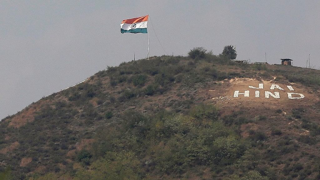 An Indian flag flies on a hill in Uri sector, near the de-facto border dividing Kashmir between India and Pakistan, in Indian controlled Kashmir.