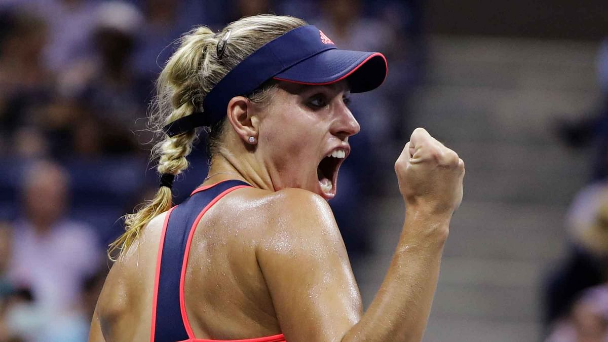 Angelique Kerber, of Germany, reacts after defeating Caroline Wozniacki, of Denmark, during the semifinals of the U.S. Open. (Photo: AP)