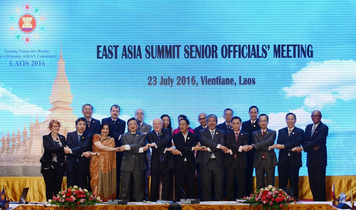 Officials take part in a group photo ahead of the summit of South Asian leaders in Laos. (Photo: IANS)