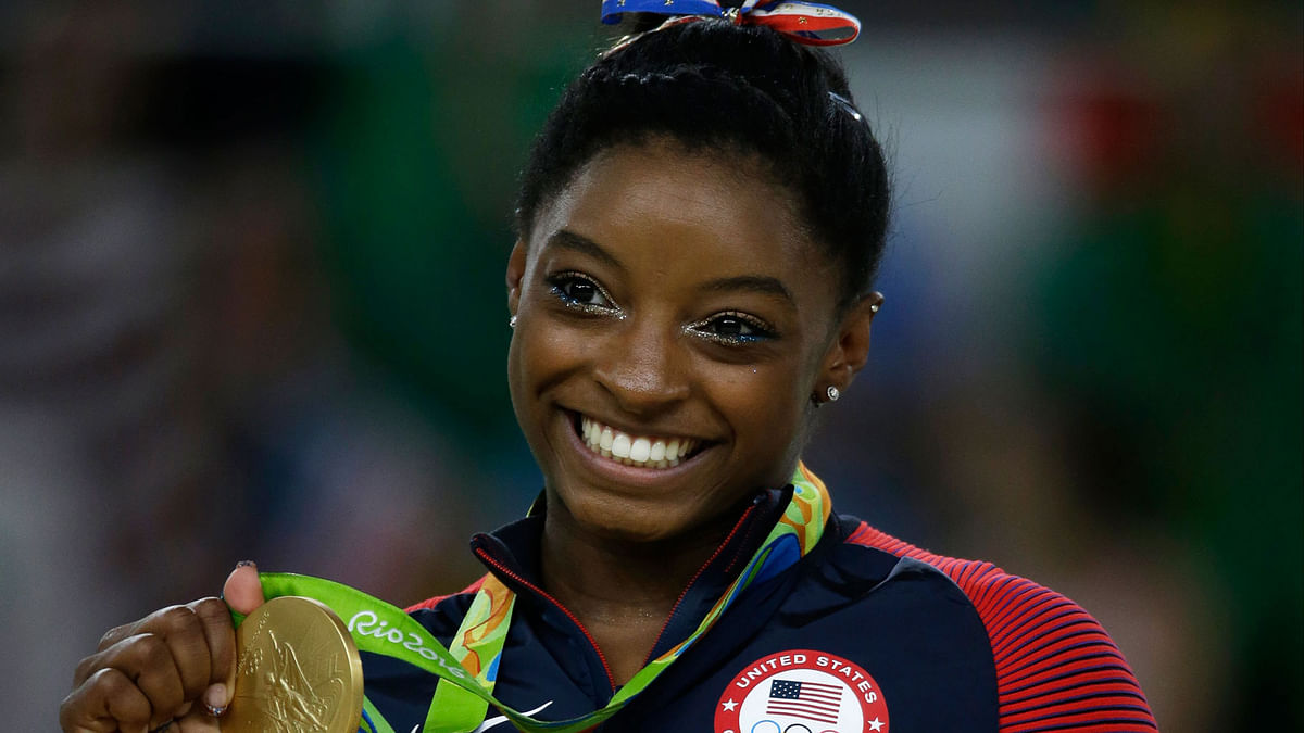 American Simone Biles smiles after receiving her gold medal at Rio Olympics. (Photo: AP)