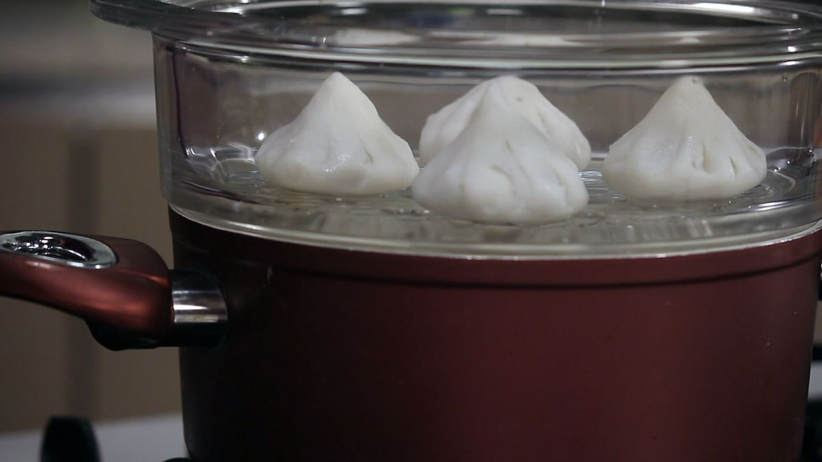 Remove the modaks from the steamer and serve hot. (Photo: The Quint)