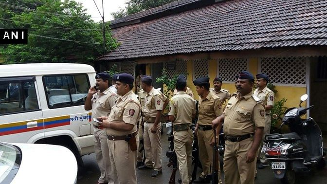 Navi Mumbai police outside the school, whose students reportedly saw a group of armed men near a naval base in Uran, Maharashtra. (Photo: ANI)
