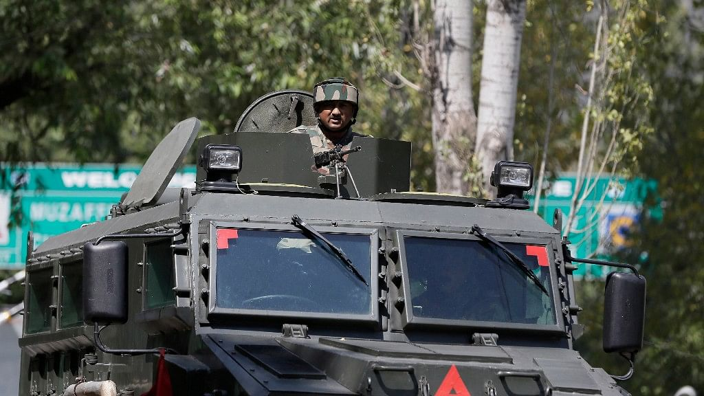 Indian army soldiers arrive at the army base which was attacked. (Photo: AP)