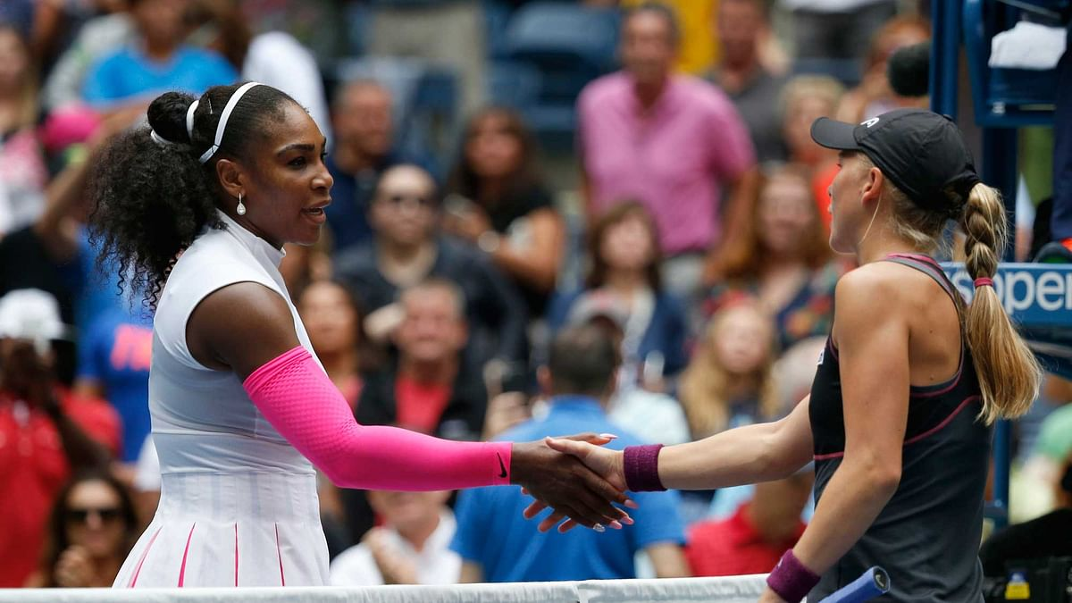 Serena Williams, left, greets Johanna Larsson, of Sweden, after winning their third round match of the U.S. Open. (Photo: AP)