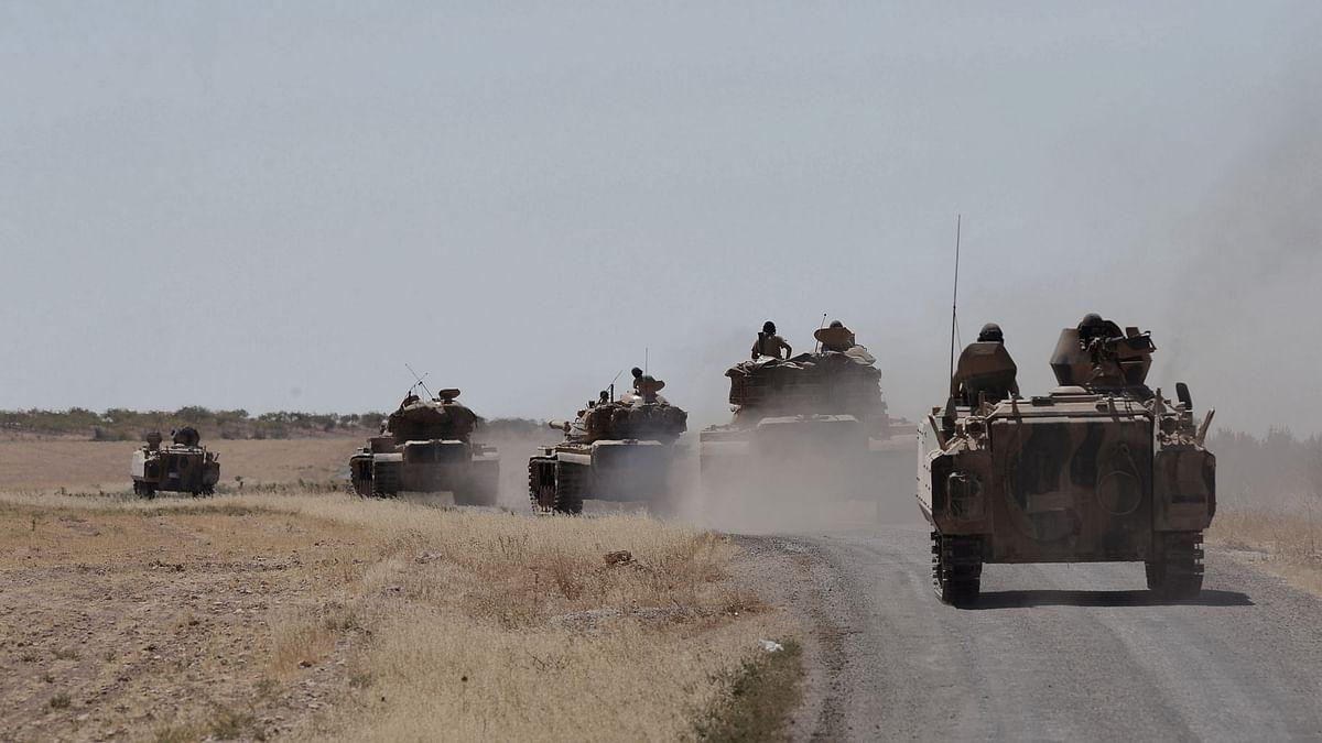 Turkish tanks head to the Syrian border, in Karkamis, Turkey. (Photo: AP)