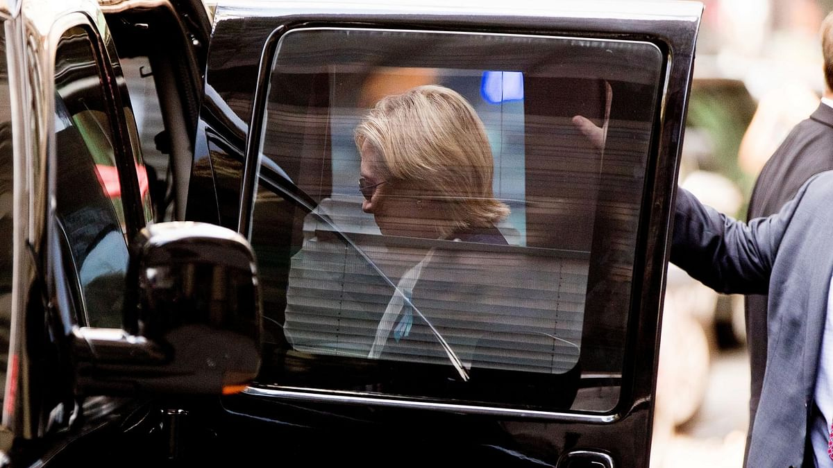 """Democratic presidential candidate Hillary Clinton gets into a van as she leaves after feeling """"overheated"""". (Photo: AP)"""