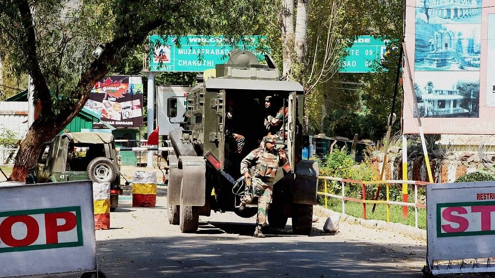 Army personnel in action inside  the army brigade camp during the Uri attack. (Photo: PTI)