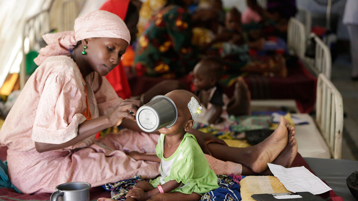 A mother feeds her malnourished child at a feeding centre run by Doctors Without Borders in Maiduguri Nigeria, Monday 29 August, 2016. (Photo: AP)